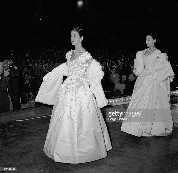 Models illustrate a lecture by designer Christian Dior entitled 'Fashion its Economic Cultural and Aesthetic Place in Modern Civilisation' at the...