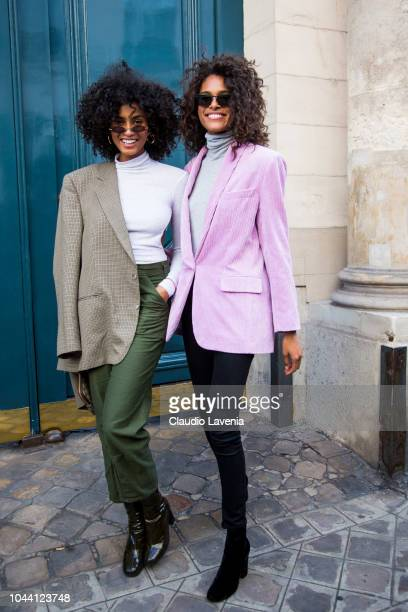 Models Imaan Hammam and Cindy Bruna are seen after the Jacquemus show, on September 24, 2018 in Paris, France.