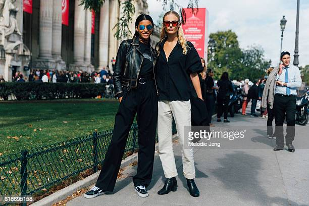 Models Imaan Hammam Frederikke Sofie after the Mugler show at Grand Palais on October 01 2016 in Paris France Imaan wears reflective sunglasses and...