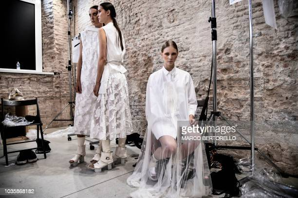 Models in backstage present creations for fashion house Alberto Zambelli as part of the Women's Spring/Summer 2019 fashion shows in Milan on...