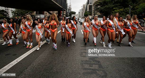 Models in bikinis perform at Paulista Avenue in Sao Paulo, Brazil on August 8 to promote the Miss Bumbum Brazil 2016 pageant. All eyes are on...