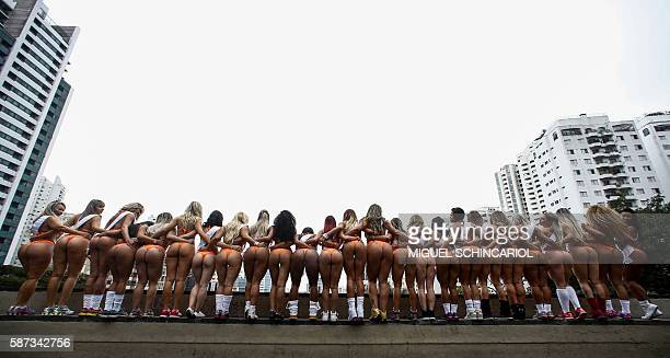Models in bikinis perform at Paulista Avenue in Sao Paulo Brazil on August 8 to promote the Miss Bumbum Brazil 2016 pageant All eyes are on Brazil's...