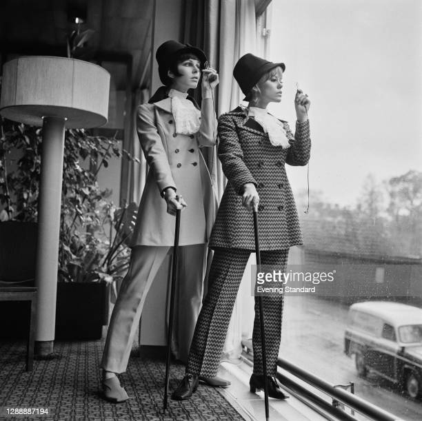 Models in trouser suits with a period twist, UK, 4th May 1967.