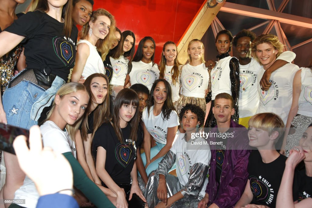 Models including Anna Cleveland, Natalia Vodianova, Kendall Jenner, Naomi Campbell, Heidi Klum, Natasha Poly, Jordan Barrett and Erin O'Connor pose at the Fashion for Relief event during the 70th annual Cannes Film Festival at Aeroport Cannes Mandelieu on May 21, 2017 in Cannes, France.