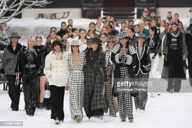 Models including Cara Delevingne walk the runway during the Chanel show as part of the Paris Fashion Week Womenswear Fall/Winter 2019/2020 on March...