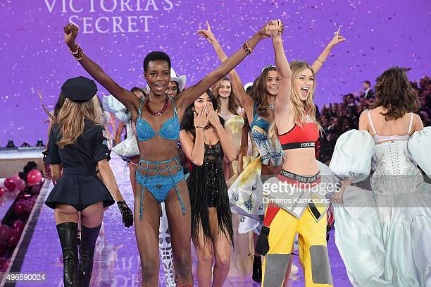 Models including Maria Borges from Angola Shanina Shaik from Australia and Gigi Hadid from California walk the runway during the 2015 Victoria's...