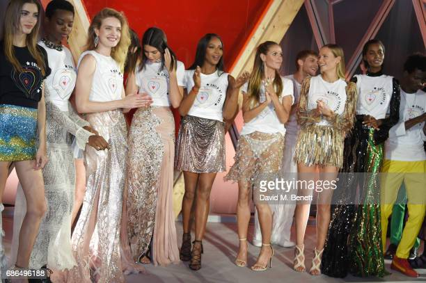 Models including Natalia Vodianova Kendall Jenner Naomi Campbell Heidi Klum and Natasha Poly the Fashion for Relief event during the 70th annual...