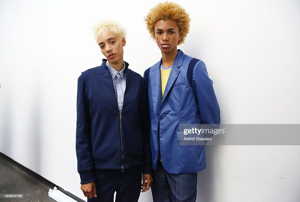 Models India Irvin, age 24, from United States and model Michael Lockley, age 17, from United States, pose at the Garciavelez Presentation during New York Fashion Week: Men's S/S 2016 at Industria Superstudio on July 13, 2015 in New York City.