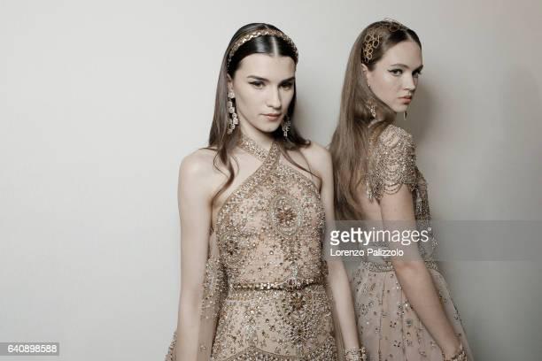 Models Irina Djuranovic and Adrienne Juliger pose Backstage prior the Elie Saab Fashion Week on January 25 2017 in Paris France