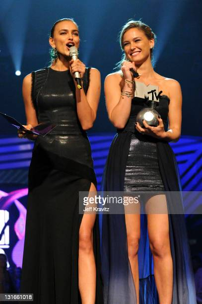 Models Irina Shayk and Bar Refaeli onstage during the MTV Europe Music Awards 2011 live show at at the Odyssey Arena on November 6 2011 in Belfast...