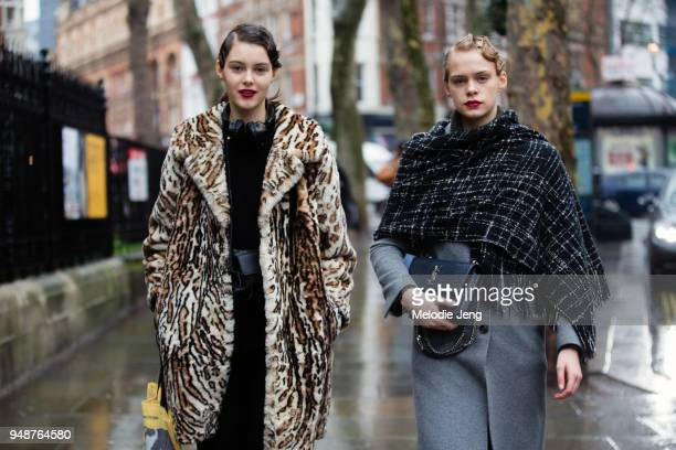 Models Irina Shnitman and Ulrikke Lundsgaard exit the Erdem show in red lipstick and 1920sstyle finger wave hair by Anthony Turner during London...