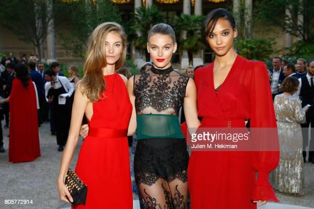 Models Iris van Berne Madison Headrick and Cora Emmanuel attends the amfAR Paris Dinner 2017 at Le Petit Palais on July 2 2017 in Paris FranceÊ