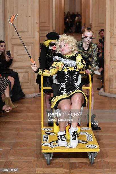A models is pushed in on a rolling toilet at the runway at the MercedesBenz Presents DB Berdan show during MercedesBenz Istanbul Fashion Week March...