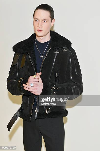Models is seen backstage ahead of the Versace show during Milan Men's Fashion Week Fall/Winter 2016/17 on January 16 2016 in Milan Italy
