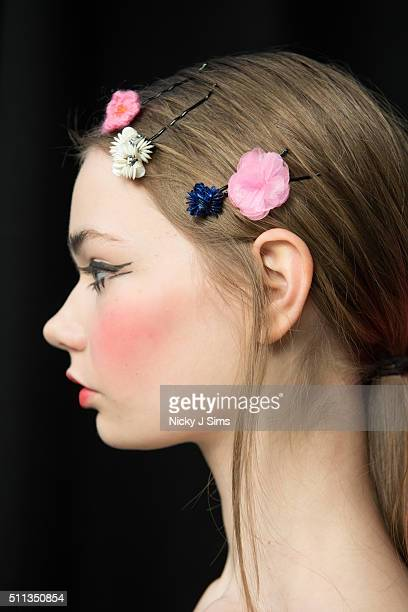 A models is seen wearing hair clips backstage prior to the Ryan Lo show on day 1 of London Fashion Week Autumn Winter 2016 at BFC Showspace on...