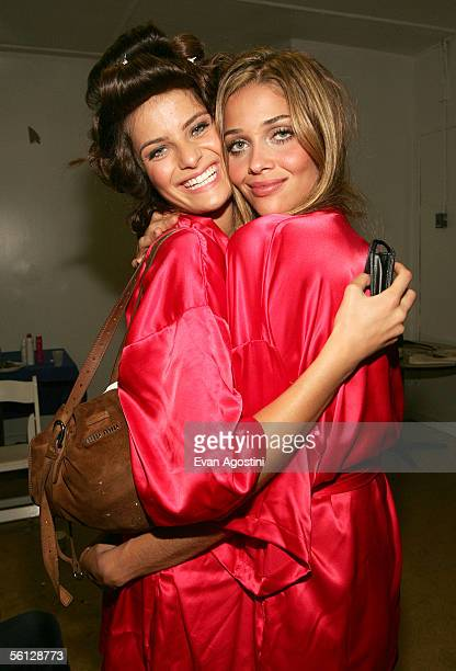 Models Isabeli Fontana and Ana Beatriz Barros pose backstage at The Victoria's Secret Fashion Show at the 69th Regiment Armory November 9 2005 in New...