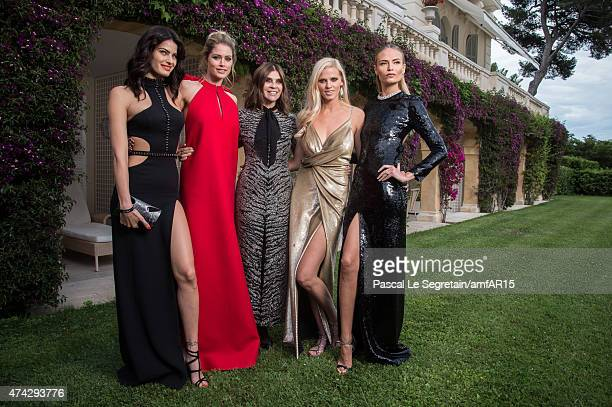 Models Isabeli Fontana, Doutzen Kroes, Designer Carine Roitfeld, Models Lara Stone and Natasha Poly attend amfAR's 22nd Cinema Against AIDS Gala,...