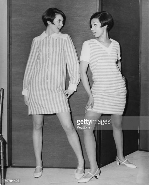 Models Jackie Moodie and Faith Ibrahim wearing striped mini dresses by Charlotte WarrenDavis at Avantgarde at the Seekers showrooms in Sloane Street...