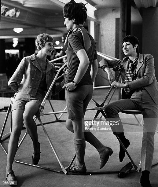 Models Jackie Nikki and Pip wearing short suits and trouser suits at a Harrods 'Gams and Geau' fashion show