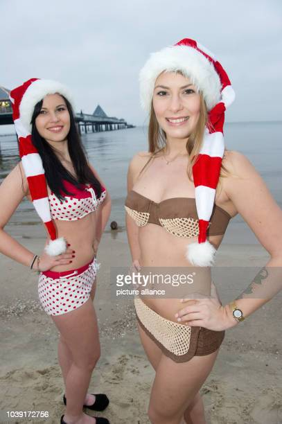 Models Jennifer and Alexandra wearing historic bikinis from the Juergen Kraft collection on the beach at Heringsdorf on the island of Usedom,...