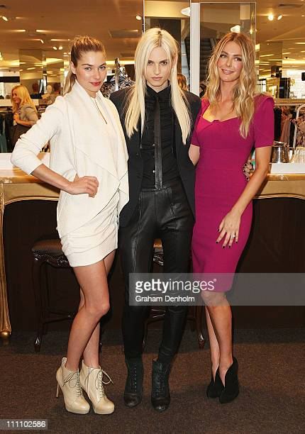 Models Jessica Hart Andrej Pejic and Jennifer Hawkins pose at the reopening of the Myer Bourke Street Store to celebrate it's 100th birthday on March...
