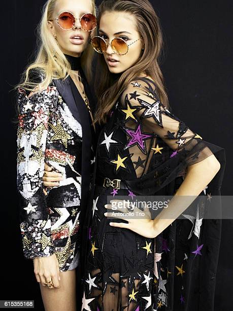 Models Jessie Bloemendaal and Camille Hurel poses prior the Elie Saab show as part of the Paris Fashion Week Womenswear Spring/Summer 2017 on October...