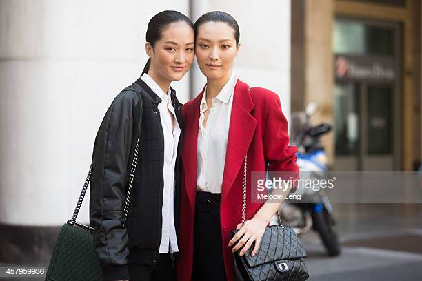 Models Jing Wen and Sunghee Kim exit Ferragamo carrying Chanel bags on Day 5 of Milan Fashion Week Spring/Summer 2015 on September 21â 2014 in Milan...