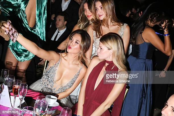 Models Jocelyn Chew Rocky Barnes Daniela Lopez and Nadine Leopold take a selfie at the Angel Ball 2016 at Cipriani Wall St on November 21 2016 in New...