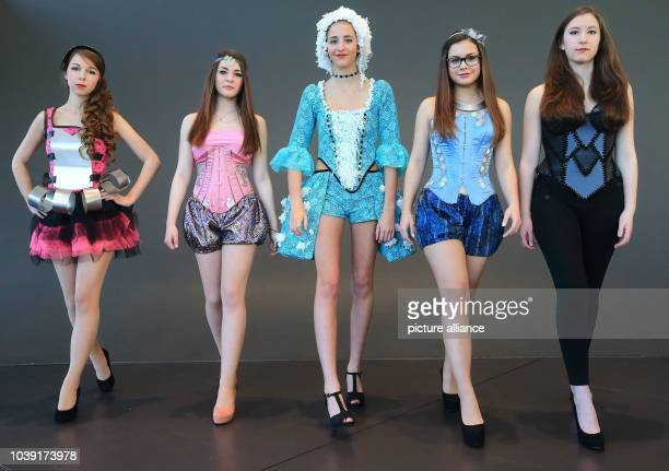 Models Josephine Nina Joanne Johanna and Kira present styles from the School for Fashion and Design at a press meeting in Magdeburg Germany 14...