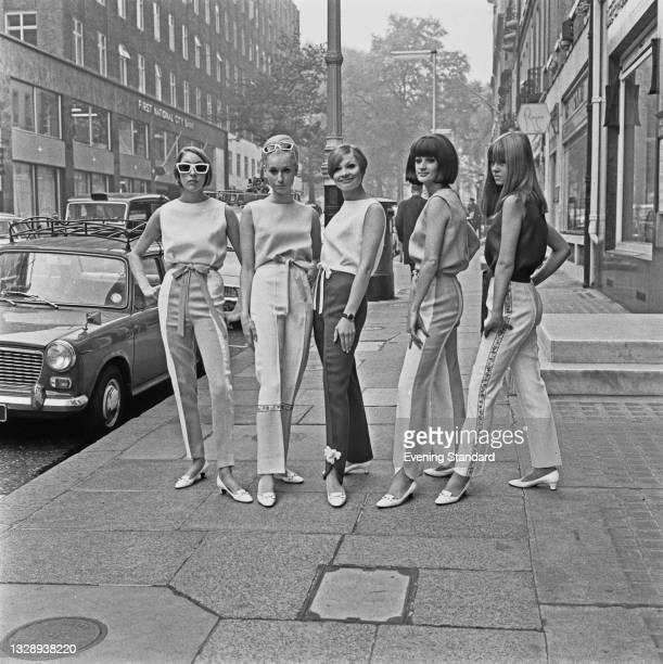 Models Judi Gomme, Joy Booth, Zoe Walker, Rocky Sandys and Jeannie Denyer in fashionable trousers, UK, 27th October 1965.