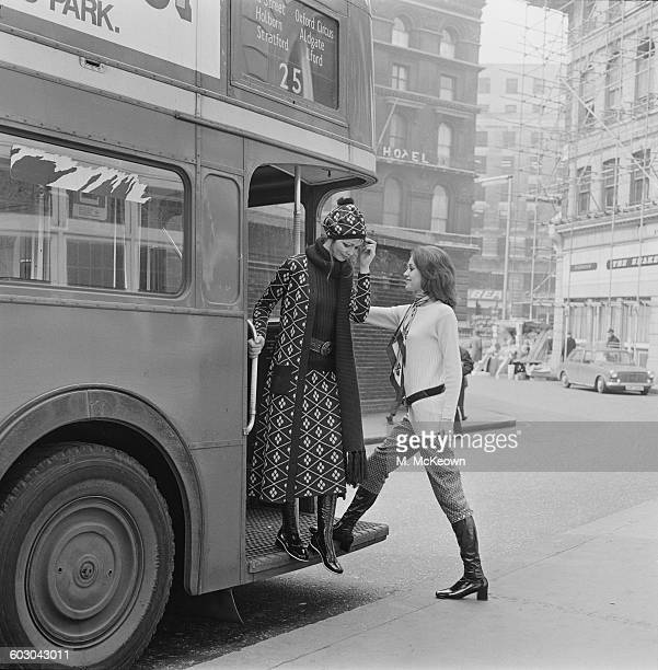 Models Judi Smith and Maria modelling winterwear on a London bus UK 9th April 1970