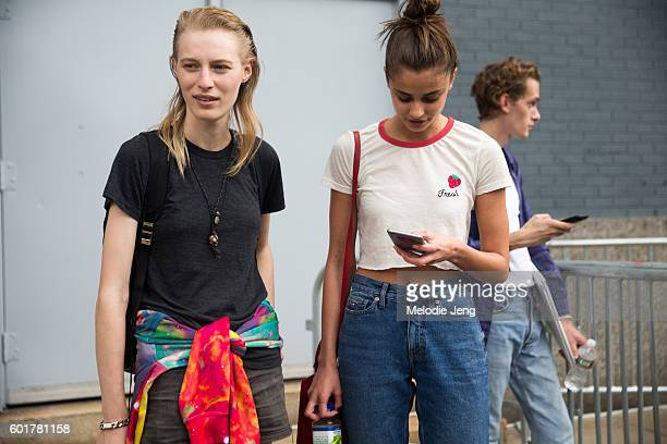 Models Julia Nobis Taylor Hill at the Jason Wu show at Spring Studios on September 9 2016 in New York City Taylor wears a top with a strawberry fruit