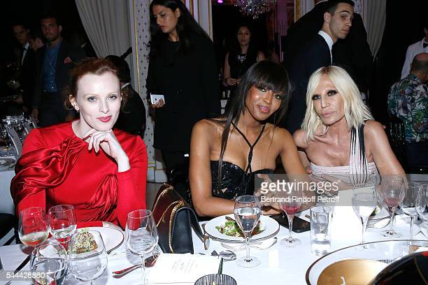 Models Karen Elson Naomi Campbell and Donatella Versace attend the Amfar Paris Dinner Stars gather for Amfar during the Haute Couture Week Held at...