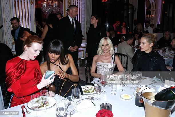 Models Karen Elson Naomi Campbell Donatella Versace and Nadine Strittmatter attend the Amfar Paris Dinner Stars gather for Amfar during the Haute...