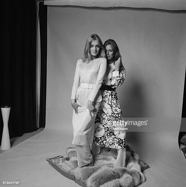 Models Kari-Ann and Jeanette Harding pose wearing maxi dresses and trousers, 26th September 1969.