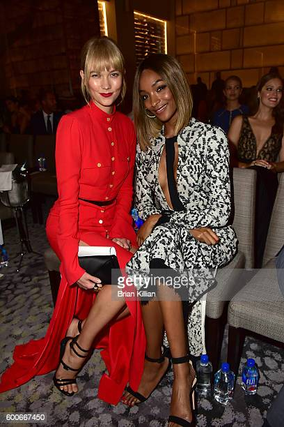 Models Karlie Kloss and Jourdan Dunn attend the FIJI Water at The Daily Front Row's 4th Annual Fashion Media Awards at Park Hyatt New York on...