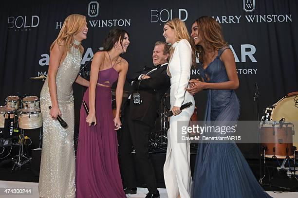 Models Karlie Kloss, Kendall Jenner, photographer Mario Testino, models Gigi Hadid and Jourdan Dunn attend amfAR's 22nd Cinema Against AIDS Gala,...