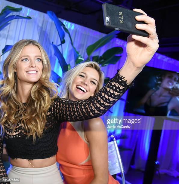 Models Kate Bock and Kelly Rohrbach pose together at the Sports Illustrated Swimsuit 2016 Swim City at the Altman Building on February 15 2016 in New...