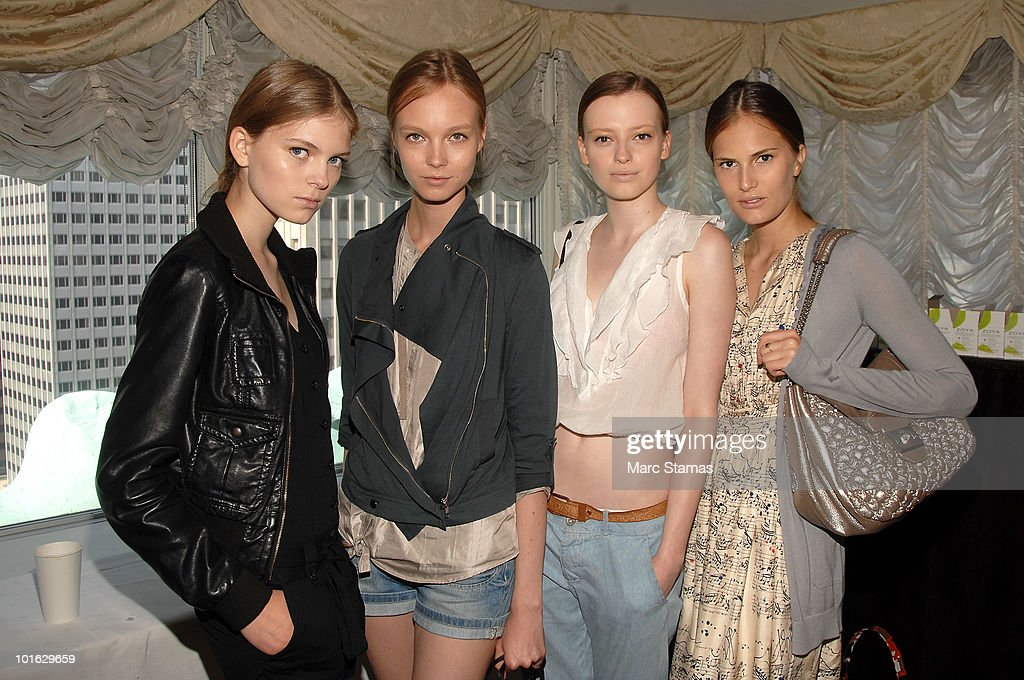 Models Kate Kosushkina (L), Anna Kuznetsova (3L) and Alla Kostronichovh (R) pose backstage at the Jason Wu Resort 2011 Collection at The St. Regis on June 4, 2010 in New York City.