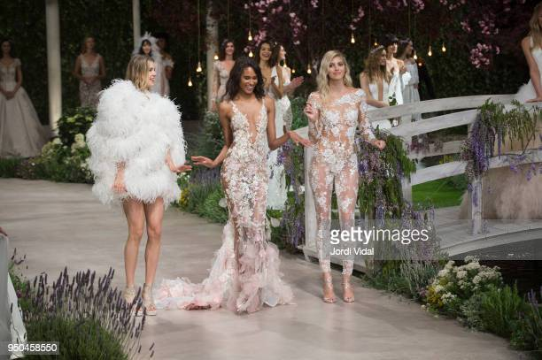 Models Keke Lindgard Cindy Bruna and Devon Windsor walk the runway for Pronovias during Barcelona Bridal Fashion Week at Fira de Barcelona on April...
