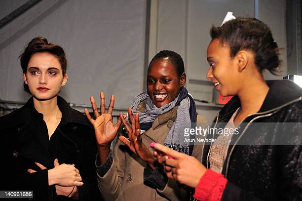 Models Kelsey Van Mook Ajak Deng and Rel Dade seen backstage at the Lela Rose fashion show during Fall 2012 Fashion Week on February 12 2012 at The...