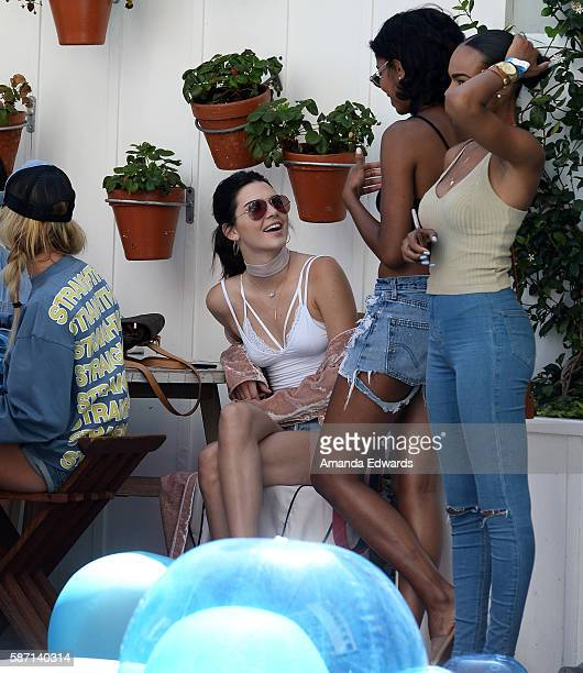 Models Kendall Jenner and Hailey Baldwin attend the NextRadio App Summer Pool Party Series with Kid Ink and Justine Skye at Mondrian Los Angeles on...