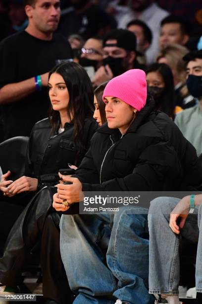Models Kendall Jenner and Justin Bieber takes in the game of the Phoenix Suns against the Los Angeles Lakers on October 22, 2021 at STAPLES Center in...