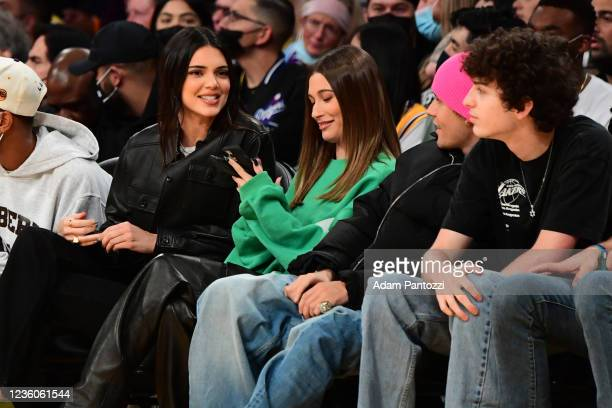 Models Kendall Jenner, Haley Bieber and Singer Justin Bieber takes in the game of the Phoenix Suns against the Los Angeles Lakers on October 22, 2021...