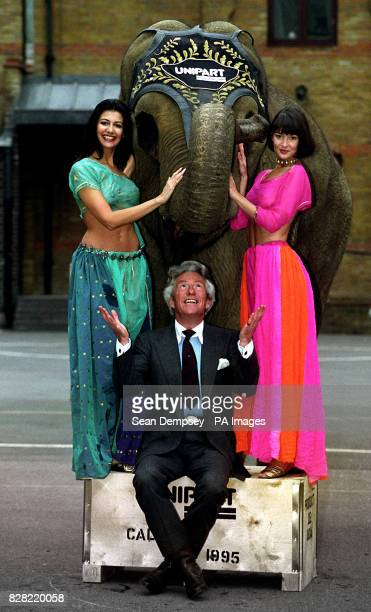 Models Kimberley Cowell and Justine Spires pose with Lord Lichfield and Rhanee the elephant
