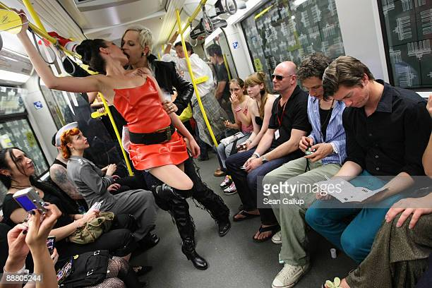 Models kiss during a fashion presentation at the Undergound Catwalk in the U5 subway train on July 2 2009 in Berlin Germany Several hundred guests...