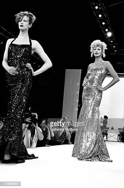 Models Kristen McMenamy and Linda Evangelista on the runway at a Kalinka fashion show in 1994 in New York City New York