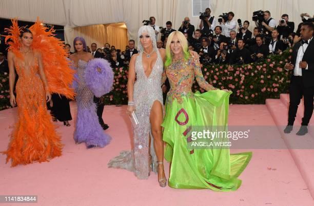 Models Kylie Jenner Kendall Jenner singer Jennifer Lopez and designer Donatella Versace arrive for the 2019 Met Gala at the Metropolitan Museum of...