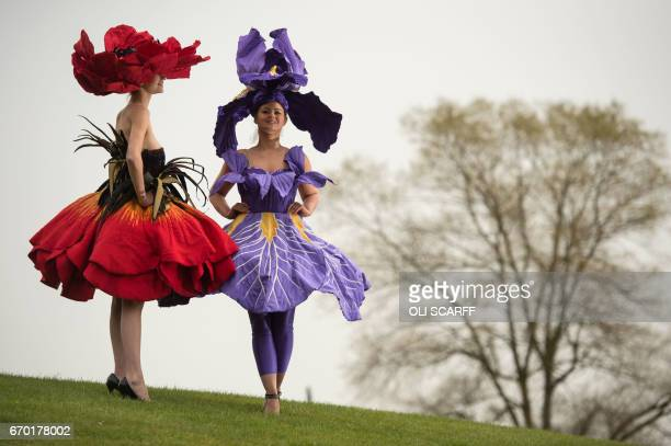 Models Lauren Green and Abi Moore wear floral dress creations representing an iris and a poppy respectively by New Zealand artist Jenny Gillies as...