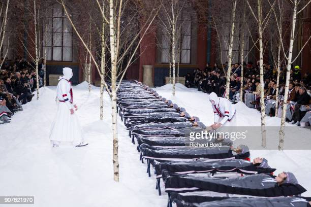 Models lay down on the runway during the Thom Browne Menswear Fall/Winter 20182019 show at Ecole des Beaux Arts as part of Paris Fashion Week on...